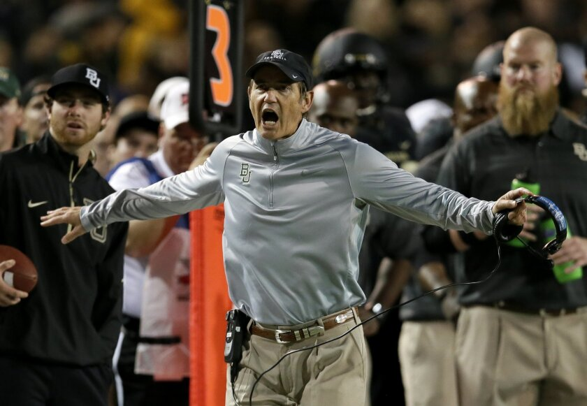 FILE - In a Nov. 7, 2013, file photo, Baylor head coach Art Briles shouts in the direction of an official late in the second half of an NCAA college football game in Waco, Texas. Once the league's perennial last-place team, Baylor has had four consecutive winning seasons. (AP Photo/Tony Gutierrez, file)