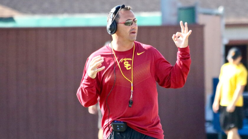USC Coach Steve Sarkisian motions to the offense during a fall camp practice at Howard Jones Field on Thursday.