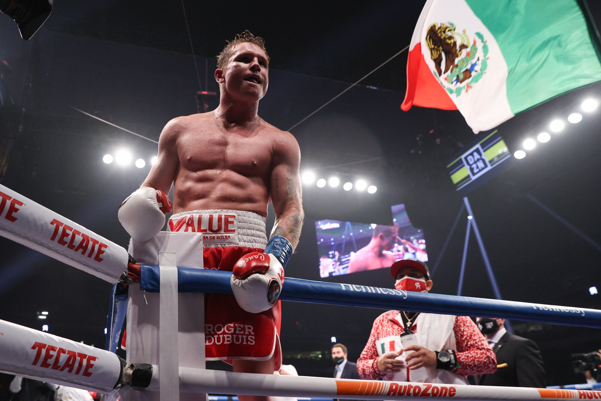 Canelo Alvarez celebrates after defeating Callum Smith by unanimous decision in a championship title fight.