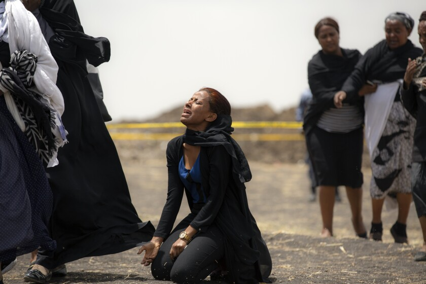 Relatives mourn victims of an Ethiopian Airlines plane crash on March 14, 2019. All 157 on board the Boeing 737 Max 8 passenger jet were killed.