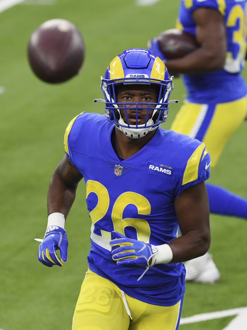 Los Angels Rams safety Terrell Burgess (26) working out on the field before game last year.