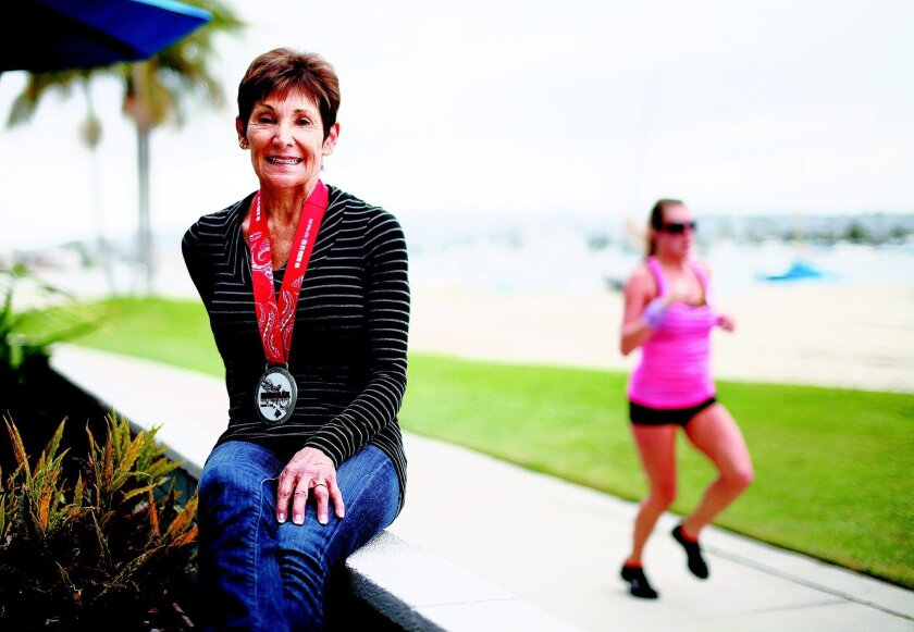 Susan Norman, 71, who won the Ironman World Championship in Kona, Hawaii, in her age group, sits on her Mission Bay patio.