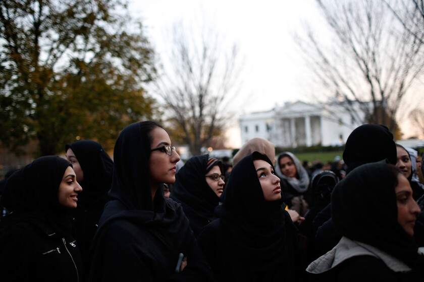 Shiite Muslims demonstrate for peace outside the White House on Sunday, before President Obama was scheduled to address the nation from the Oval Office.