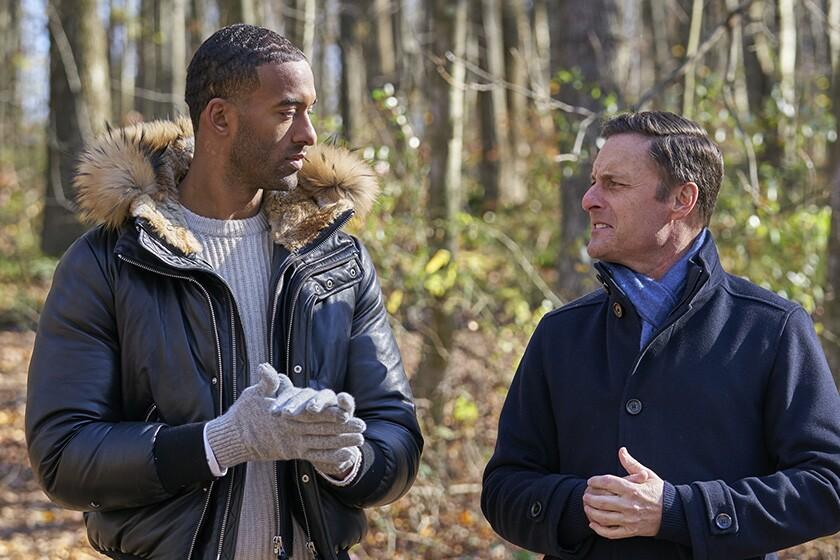 Two men in the woods wearing jackets