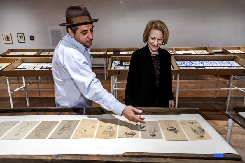 Fowler Museum Director Marla Berns with Richard Montoya, reviewing some of his father's drawings in 2016.