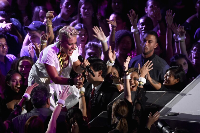 Pink interacts with the crownd during her performance.