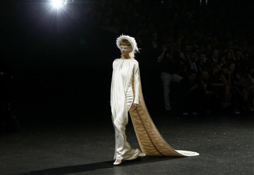 A model wears a creation for the Chanel Fall-Winter 2011-2012 Haute Couture fashion collection presented in Paris, Tuesday, July 5, 2011. (AP Photo/Francois Mori)