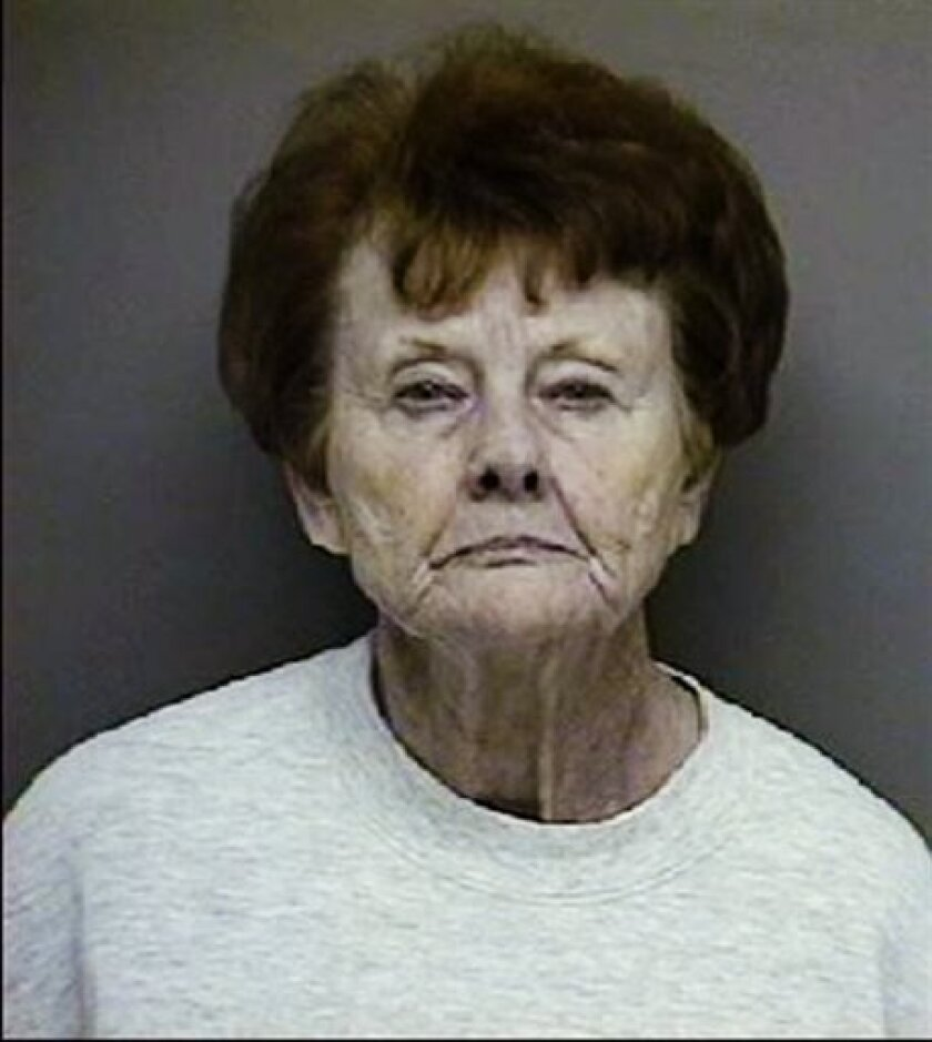 This booking photo provided by the Montgomery County, Texas, District Attorney, shows Dorothy Canfield, 84. Montgomery County District Attorney Brett Ligon on Monday April 15, 2013, said Canfield of Willis, Texas, sought to have him attacked and Assistant District Attorney Rob Fryer slain. (AP Photo/Montgomery County District Attorney)