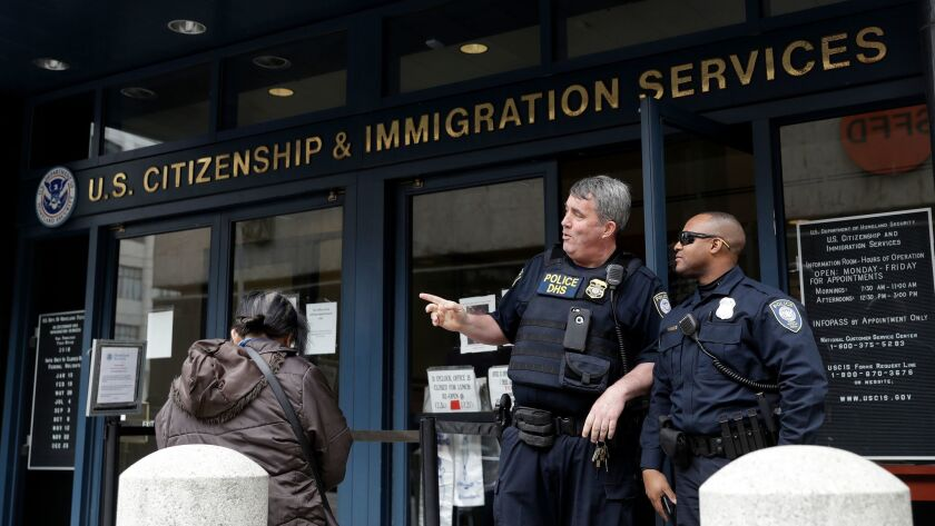 The entrance to the Immigration and Customs Enforcement office is guarded Wednesday, Feb. 28, 2018,