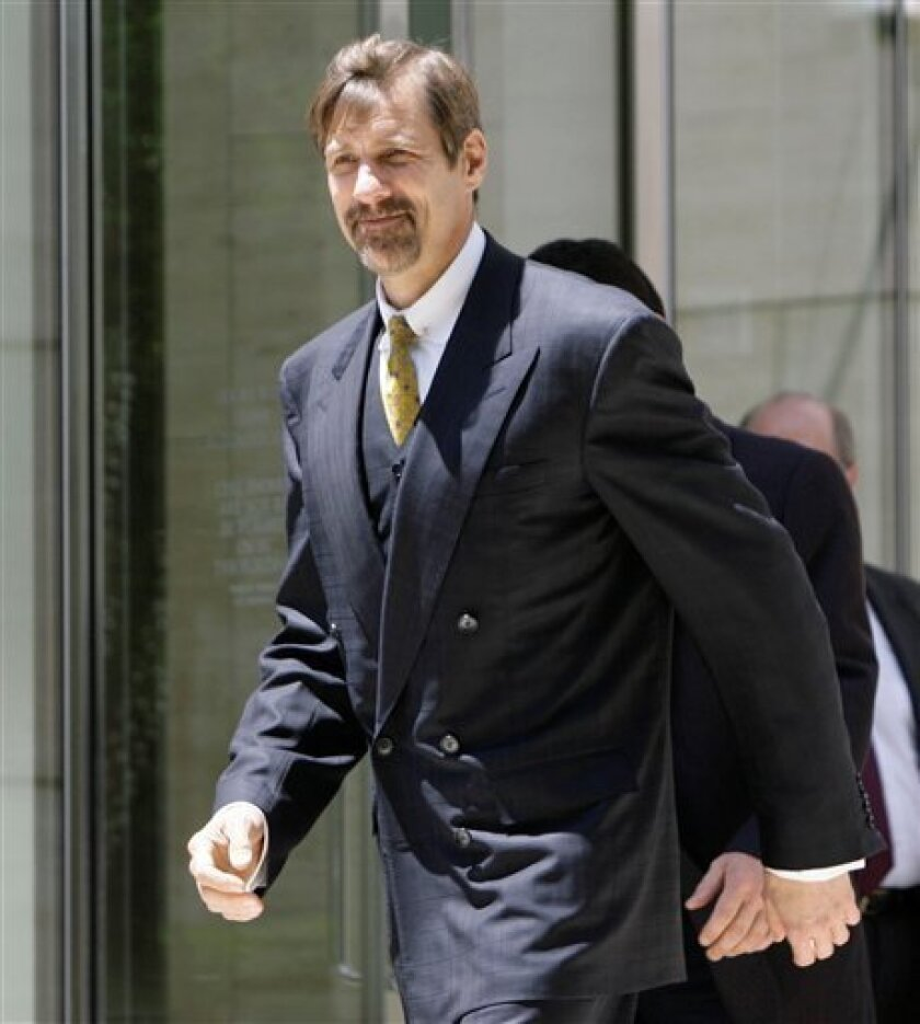 FILE - In this Monday, June 16, 2008 picture, Broadcom co-founder Henry T. Nicholas III leaves the Ronald Reagan Federal Building after a hearing in Santa Ana, Calif. A federal judge is considering a request from prosecutors to dismiss felony narcotics charges against Nicholas. (AP Photo/Nick Ut)