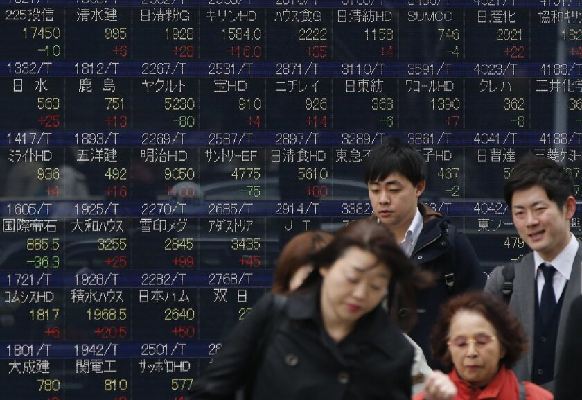 People walk past an electronic stock board showing Japan's stock prices at a securities firm in Tokyo, Thursday, March 24, 2016. Asian stock markets fell for a second day Thursday after declines in prices of oil and other commodities pulled Wall Street lower. (AP Photo/Shuji Kajiyama)