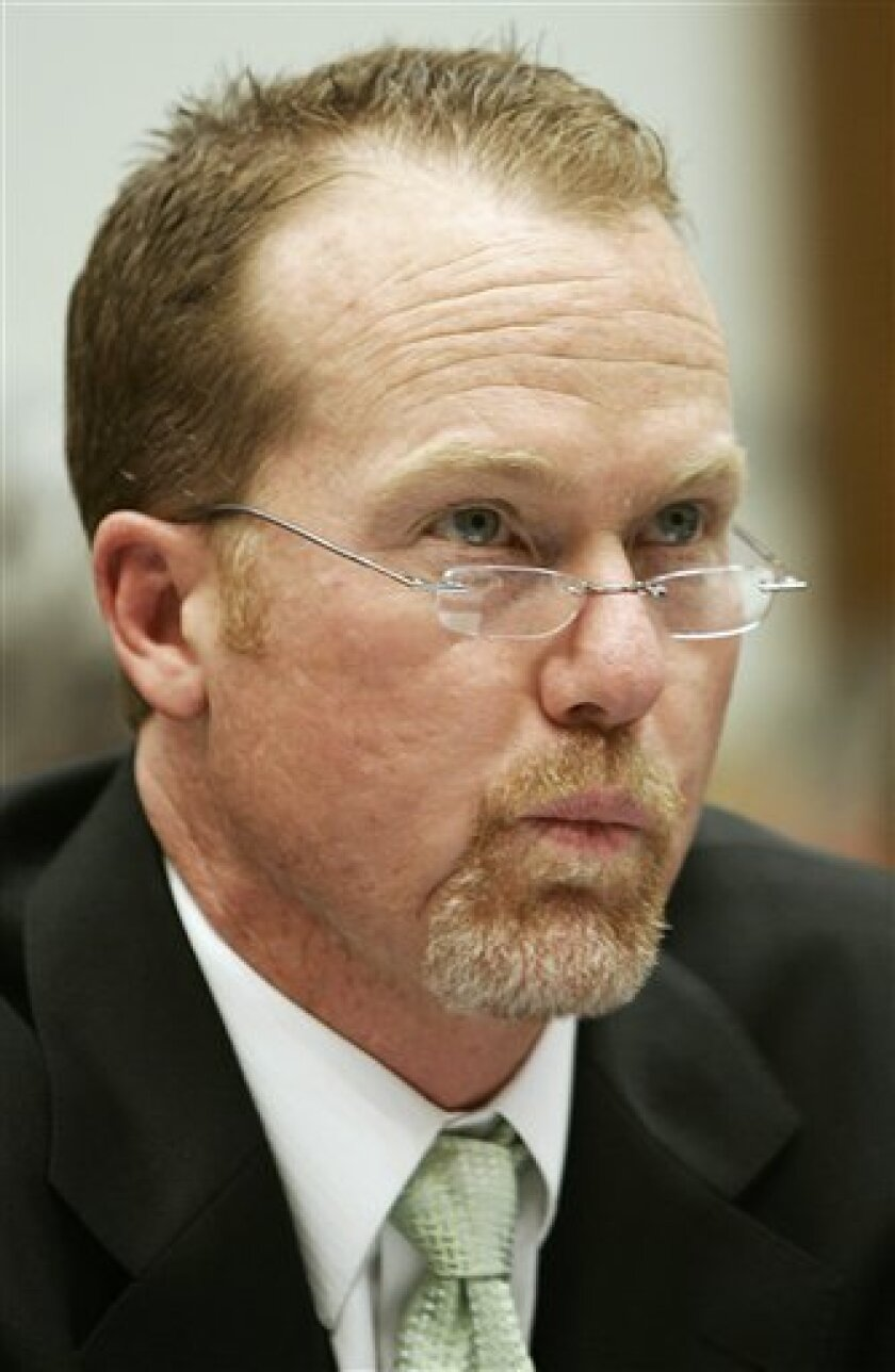 FILE -- This is a March 17, 2005, file photo showing Mark McGwire testifying on Capitol Hill during a hearing on the use of steroids in professional baseball. The Cardinals said Monday, Oct. 26, 2009,  that Tony La Russa had agreed to a one-year contract for a 15th season as manager and that McGwir