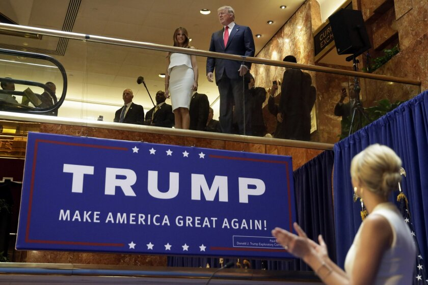 FILE - In this June 16, 2015, file photo, Donald Trump, accompanied by his wife Melania Trump, is applauded by his daughter Ivanka Trump, right as he's introduced before his announcement that he will run for president in the lobby of Trump Tower in New York. In AP's delegate count, Donald Trump sur