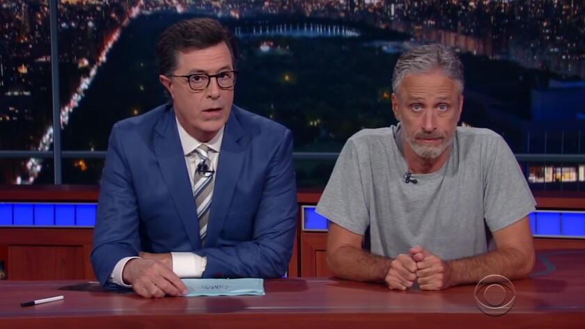 Jon Stewart, right, joins Stephen Colbert on 'The Late Show.'