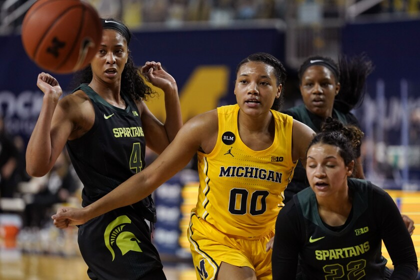 Michigan forward Naz Hillmon (00), Michigan State forward Alisia Smith (4) and Michigan State guard Moira Joiner (22) watch the rebound go out of bounds during the first half of an NCAA college basketball game, Tuesday, Feb. 16, 2021, in Ann Arbor, Mich. (AP Photo/Carlos Osorio)