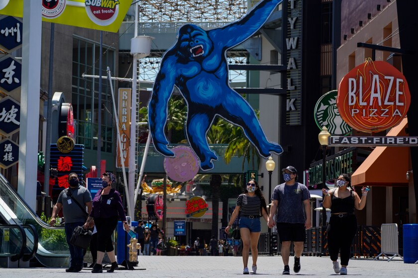 People stroll through Universal CityWalk in Los Angeles on Thursday.