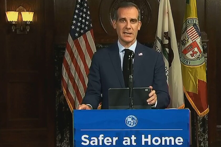 Los Angeles Mayor Eric Garcetti updates residents during a media briefing as coronavirus cases in the county surge.