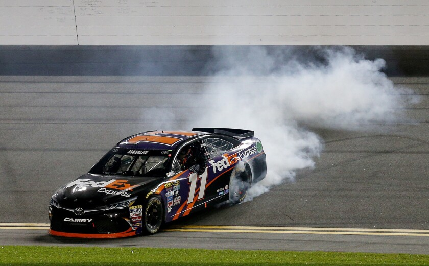 Denny Hamlin wins the Sprint Unlimited, an exhibition race and prelude to the Daytona 500