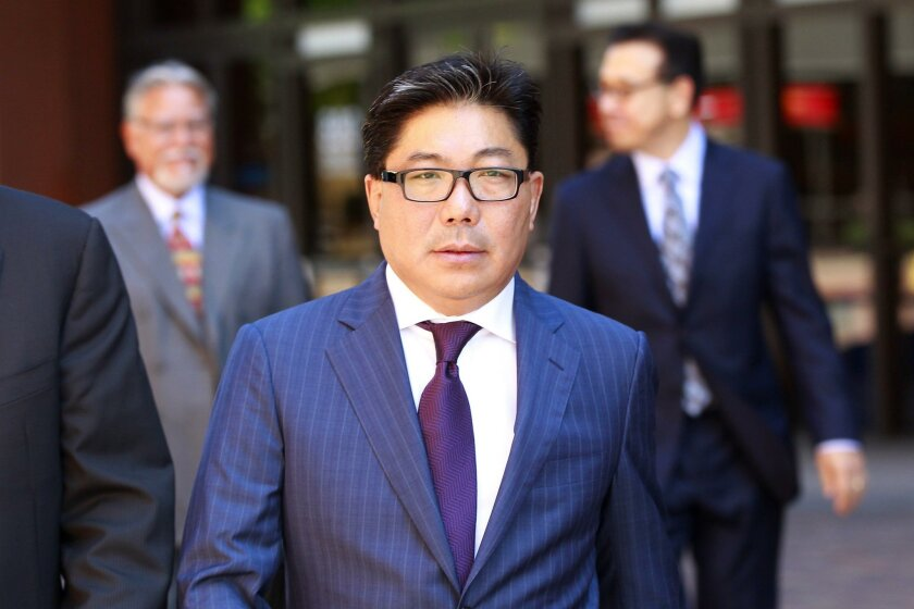 José Susumo Azano Matsura is shown in 2014 walking into San Diego federal court with his lawyers.