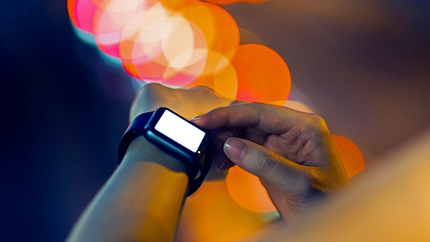Smart watch outdoors at night
