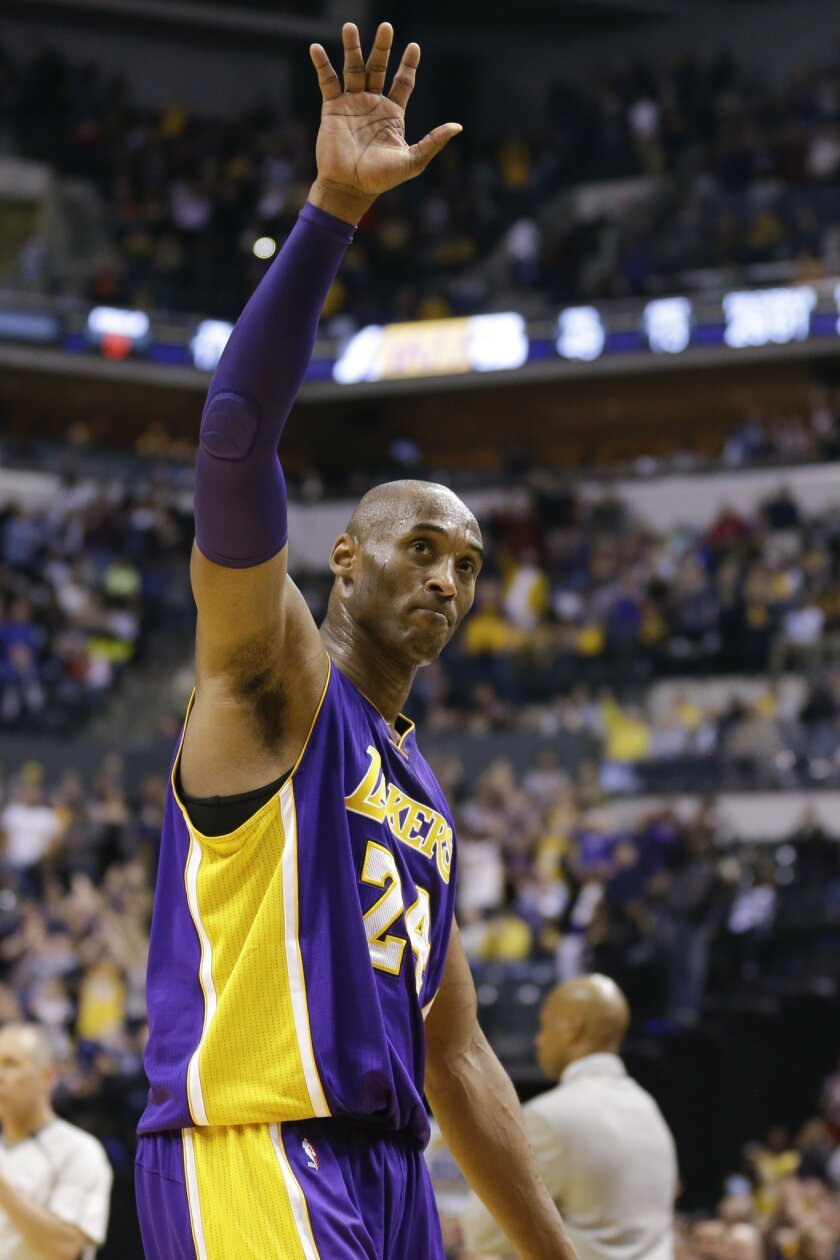Los Angeles Lakers forward Kobe Bryant (24) waves to fans as he leaves the game in the final seconds of the second half of an NBA basketball game against the Indiana Pacers in Indianapolis, Monday, Feb. 8, 2016. The Pacers defeated the Lakers 89-87. (AP Photo/Michael Conroy)