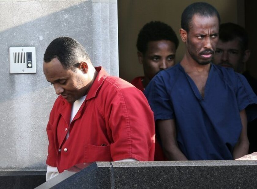 Shani Nurani Shiekh Abrar, left, and Ahmed Muse Salad, right leave the federal courthouse in Norfolk, Va., in June. The two men and a third Somali pirate, Abukar Osman Beyle, were sentenced Friday in the 2011 shooting deaths of four Americans off the coast of Africa. *