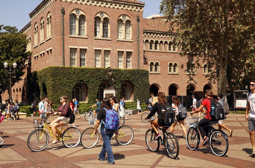 Students traverse  across the USC campus.