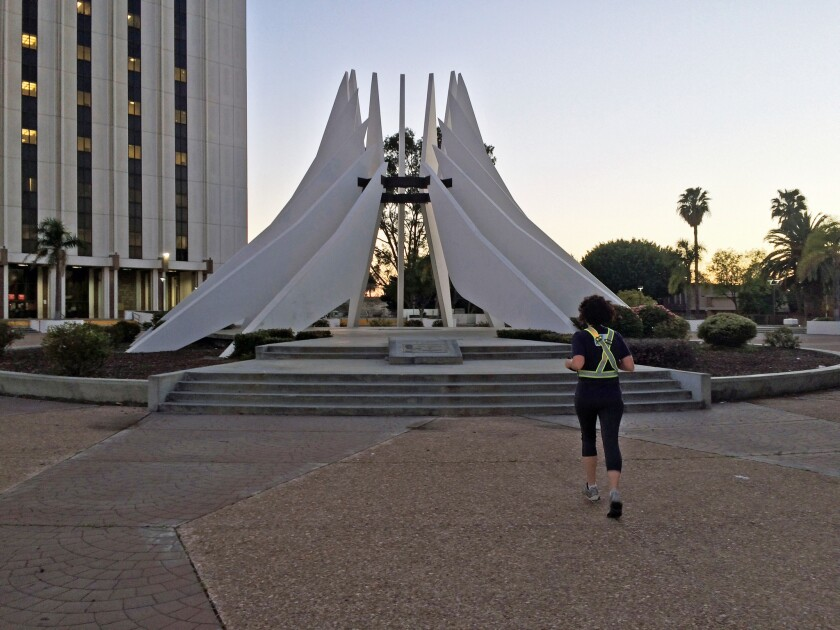 A series of runs adding up to more than 120 miles took a trio of runners all over Los Angeles. Seen here: Abbie Swanson at the Martin Luther King Jr. memorial in Compton.