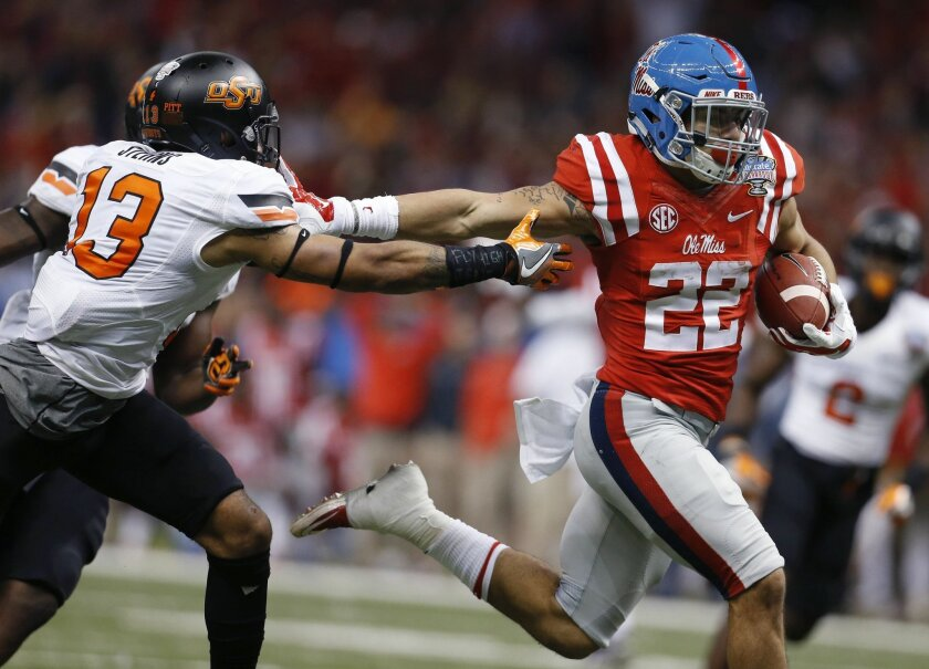 Mississippi running back Jordan Wilkins (22) carries for a touchdown as Oklahoma State safety Jordan Sterns (13) pursues in the second half of the Sugar Bowl college football game in New Orleans, Friday, Jan. 1, 2016. (AP Photo/Jonathan Bachman)