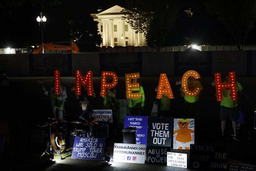 """Protesters with """"Kremlin Annex"""" call to impeach President Donald Trump in Lafayette Square Park in front of the White House in Washington, Tuesday, Sept. 24, 2019. House Speaker Nancy Pelosi of Calif., announced a formal impeachment inquiry into President Donald Trump. (AP Photo/Carolyn Kaster)"""