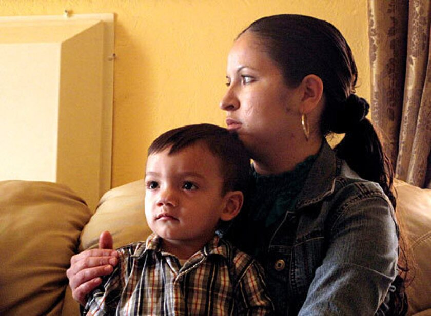 Maura Alatorre holds her 2-year-old son Emannuel at her home Wednesday in Kettleman City, Calif.
