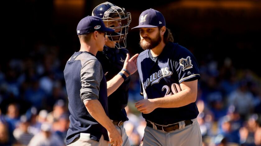 Brewers starter Wade Miley is pulled by manager Craig Counsell after facing one Dodgers hitter in Game 5 of the National League Championship Series on Oct. 17.