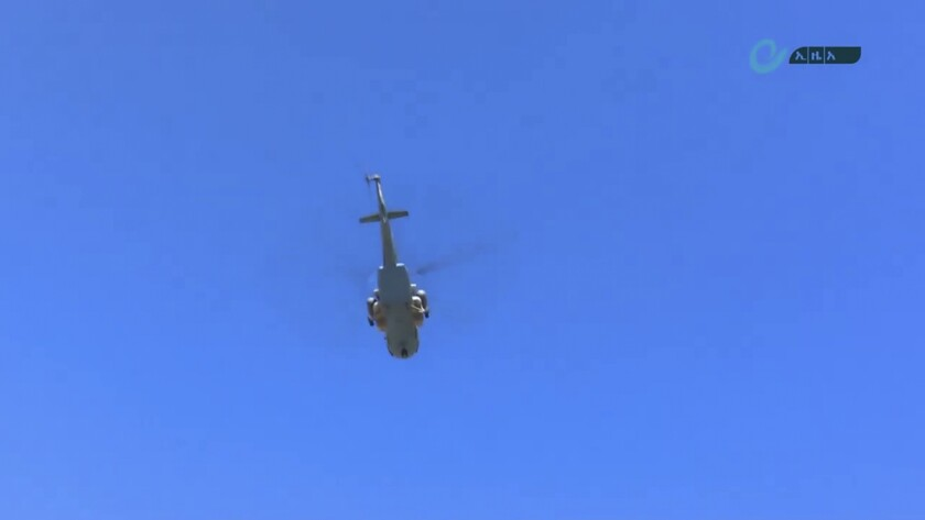 """This image made from undated video released by the state-owned Ethiopian News Agency on Monday, Nov. 16, 2020 shows a helicopter in the sky over an area near the border of the Tigray and Amhara regions of Ethiopia. Ethiopia's prime minister Abiy Ahmed said in a social media post on Tuesday, Nov. 17, 2020 that """"the final and crucial"""" military operation will launch in the coming days against the government of the country's rebellious northern Tigray region. (Ethiopian News Agency via AP)"""