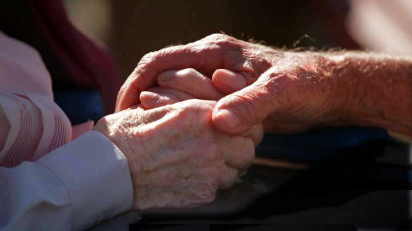 Peter Burnes 87, holds the hands of his wife Ferne Burnes 88, who is suffering from Alzheimer's Dise