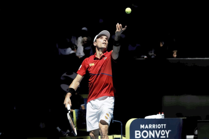 Roberto Bautista Agut of Spain serves to Go Soeda of Japan during their match at the ATP Cup in Perth, Australia, Wednesday, Jan. 8, 2020. (AP Photo/Trevor Collens)