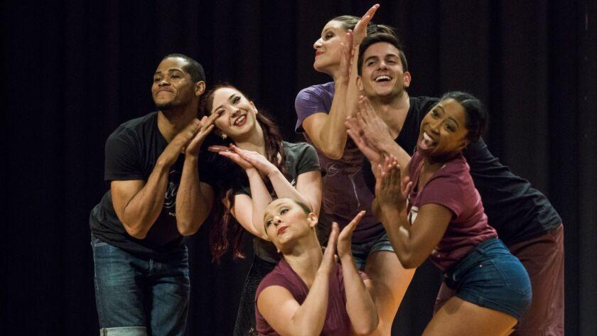 "Ron ""RJ"" Davis, left, and the PGK Dance Project. Jim Carmody photo"