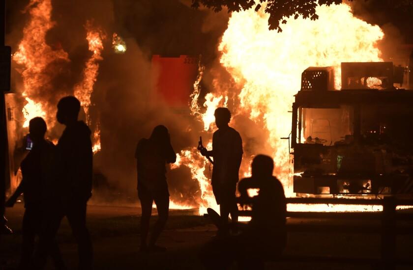 Garbage and dump trucks were set ablaze Aug. 23, 2020, near the Kenosha County Courthouse in Wisconsin.
