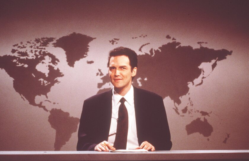 """Norm Macdonald anchoring """"Weekend Update"""" during an airing of Saturday Night Live."""