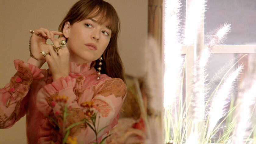Dakota Johnson appears in Gucci's fragrance campaign for Gucci Bloom Nettare di Fiori. The scent features notes of rose, osmanthus, jasmine, Rangoon creeper, tuberose, ginger and patchouli.