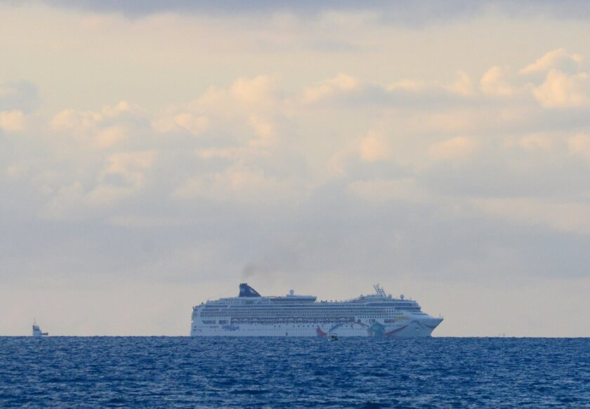 In this photo provided by the Royal Gazette, the Norwegian cruise ship Norwegian Dawn, lies aground near Bermuda's North Channel Tuesday, May 19, 2015. Thousands of passengers bound for Boston will spend Tuesday night stuck aboard a Norwegian cruise ship after it ran aground as it tried to depart Bermuda, officials and passengers said. (Akil Simmons/The Royal Gazette photo via AP) - BERMUDA OUT - NOT FOR USE IN BERMUDA PUBLICATIONS