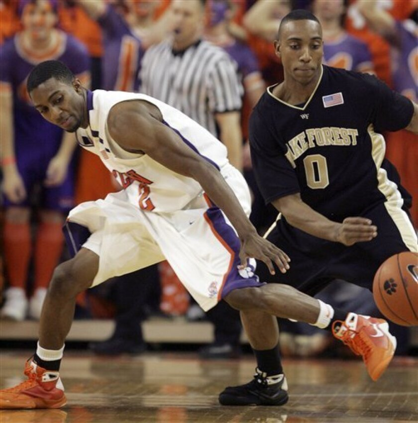 Wake Forest's Jeff Teague, right, forces a turnover as Clemson's Demontez Stitt (2) loses control of the ball during the first half of an NCAA college basketball game Saturday Jan. 17, 2009, at Littlejohn Coliseum in Clemson, S.C. Wake Forest defeated Clemson 78-68. (AP Photo/Mary Ann Chastain)