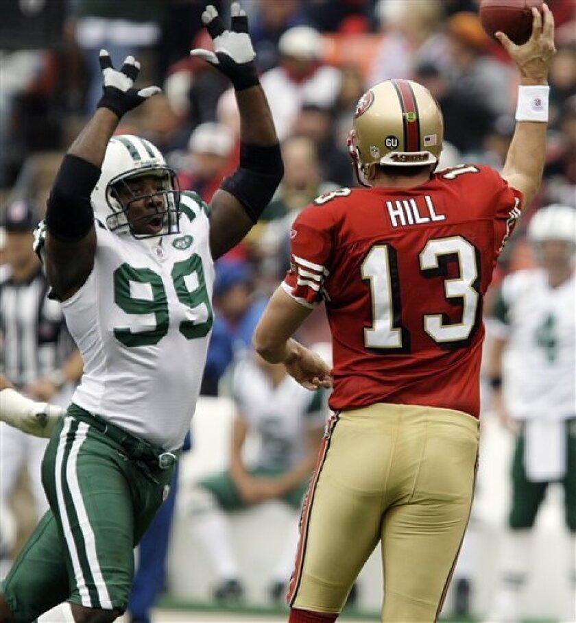 New York Jets linebacker Bryan Thomas (99) pressures San Francisco 49ers quarterback Shaun Hill (13) in the second quarter of an NFL football game Sunday, Dec. 7, 2008, in San Francisco. (AP Photo/Ben Margot)