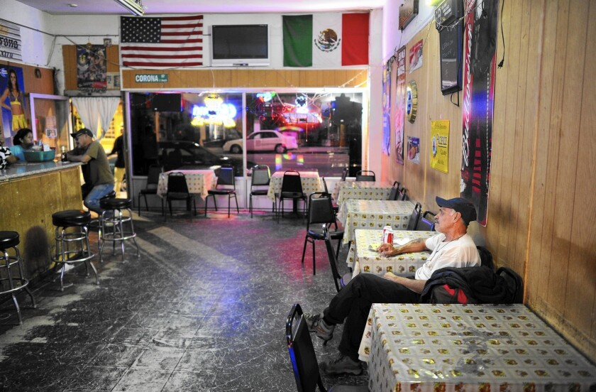 The closure of the Las Palomas bar in Boyle Heights reflects the gentrification in the Eastside neighborhood. Above, customers at the bar in March 2015.