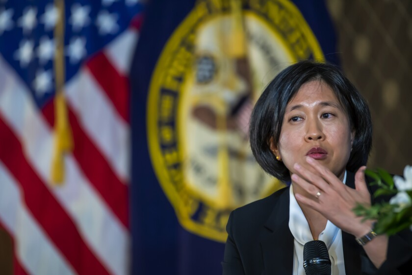 """US Trade Representative Katherine Tai speaks during a discussion, at the Geneva Graduate Institute on the role of the World Trade Organization (WTO) in the global economy, in Geneva, Switzerland, Thursday, Oct. 14, 2021. A top U.S. trade official says the Biden administration remains committed to an easing of rules that protect the technology behind coronavirus vaccines so that they can be produced more widely. Katherine Tai, the U.S. trade representative, acknowledged some nongovernmental groups and others outside the talks might perceive the U.S. to have maintained """"silence"""" on the issue in recent months. (Martial Trezzini/Keystone via AP)"""
