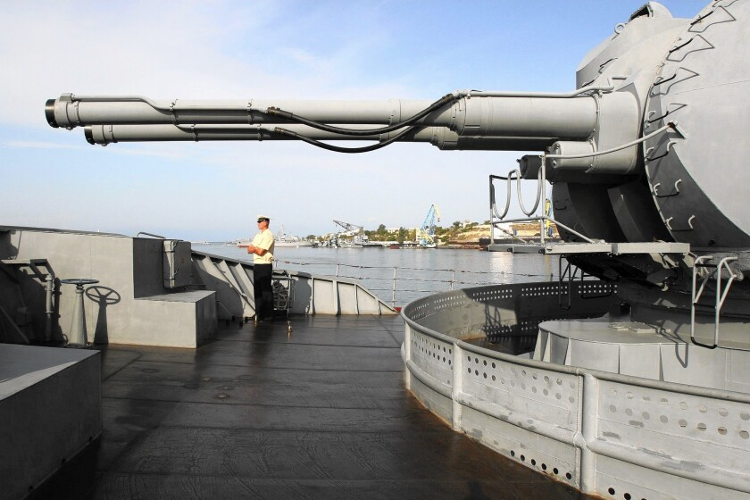A Russian navy officer aboard the guided-missile cruiser Moskva.