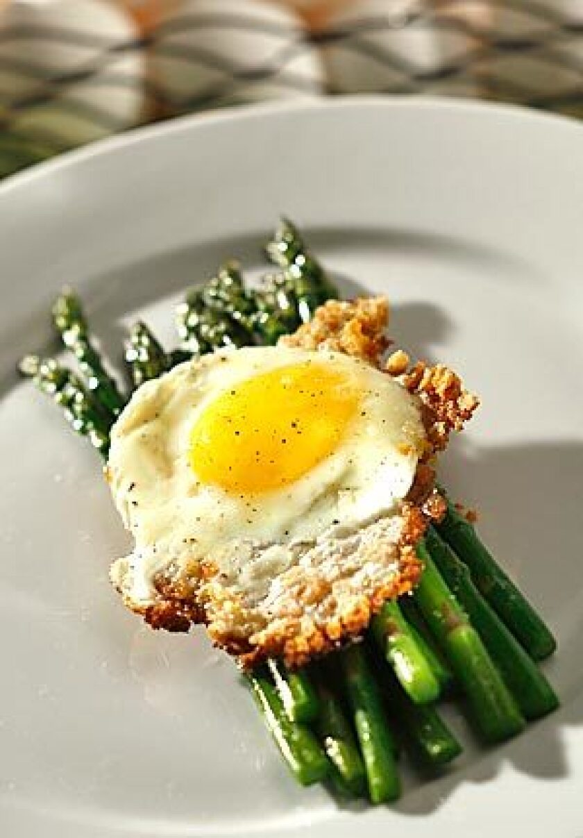 Fried eggs with asparagus and bread crumbs can make a simple dinner seem fancy. Common ingredients work well with eggs.