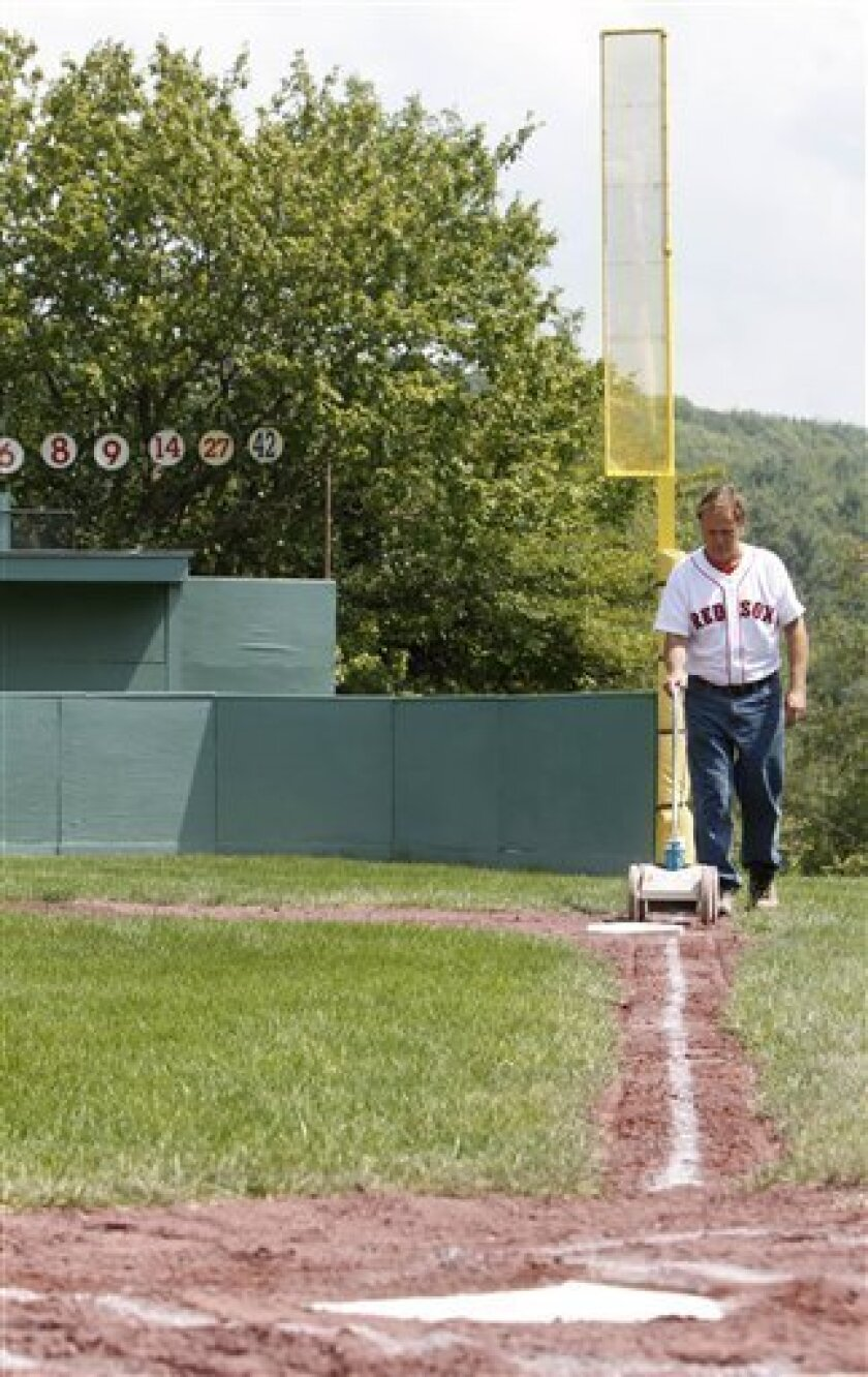 Pat O'Connor lines the right field line at Little Fenway, a scaled-down version of the major league field in Essex, Vt., Monday, Aug. 2, 2010. Little Fenway is a unique 1/4th scale replica of Boston's Fenway Park in the backyard of Pat & Beth O'Connor's house in Essex, Vermont. It was built in 2001