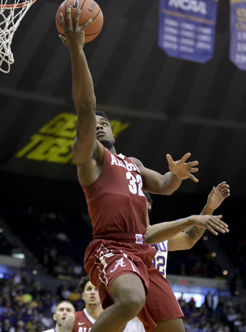 Alabama guard Retin Obasohan shoots a layup past LSU forward Craig Victor II (32) during an NCAA college basketball game Wednesday, Feb. 17, 2016, in Baton Rouge, La. Alabama won 76-69. (Hilary Scheinuk/The Advocate via AP)