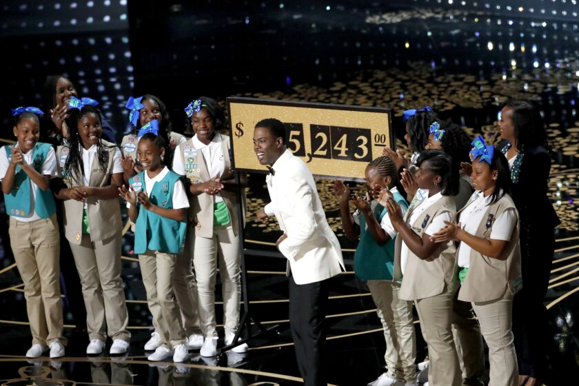 Chris Rock and Girl Scouts from Los Angeles during the telecast of the 88th Academy Awards at the Dolby Theatre.