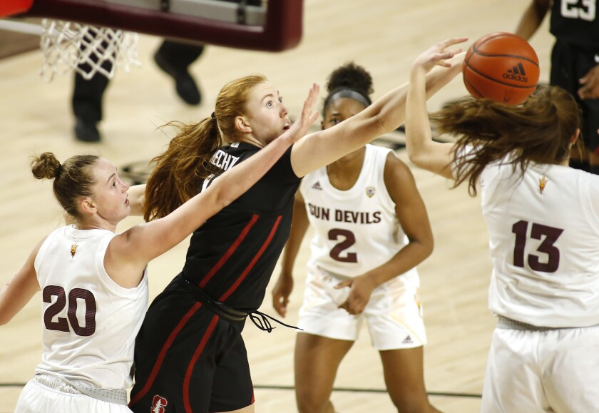 Stanford's Ashten Prechtel (11) goes for a rebound Arizona State's Katelyn Levings (20), Jaddan Simmons (2), and Maggie Besselink (13) during the first half of an NCAA college basketball game Sunday, Jan 3, 2021, in Tempe, Ariz. (AP Photo/Darryl Webb)
